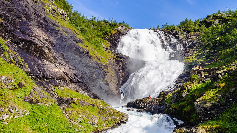 Beautiful legendary Huldra (a seductive forest creature in Scandinavian folklore) dance on the Kjosfossen waterfall in Norway